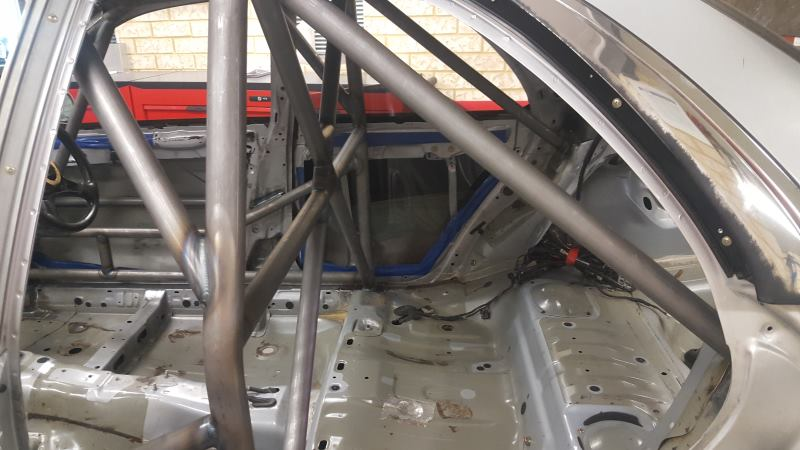 Weld in tower to tower roll cage fitted